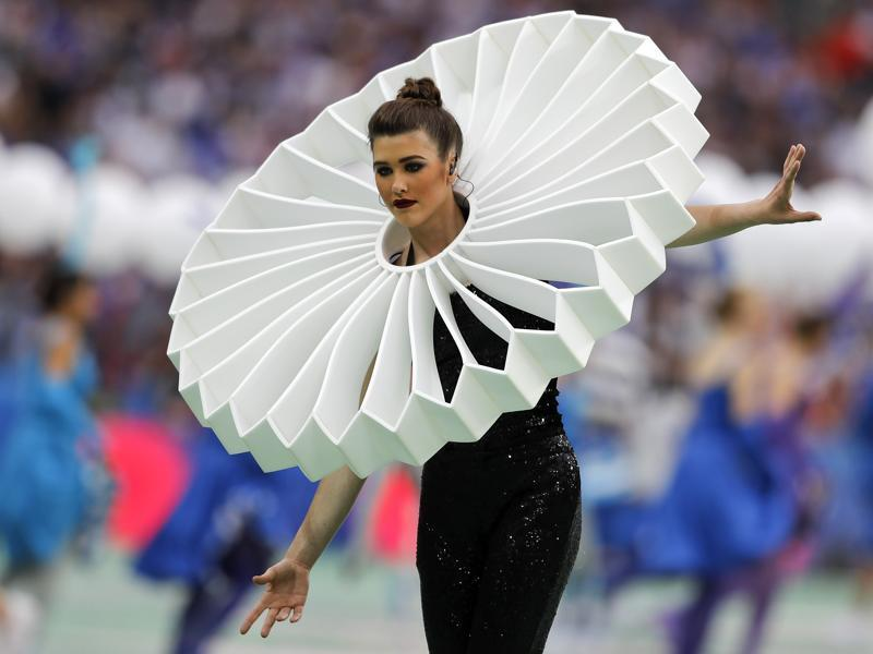 An artist performs during the opening ceremony of the Euro 2016 championship, prior to the Group A soccer match between France and Romania. (AP)