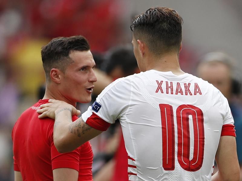 Granit and Taulant Xhaka exchanged hugs at the end of the game. (REUTERS)