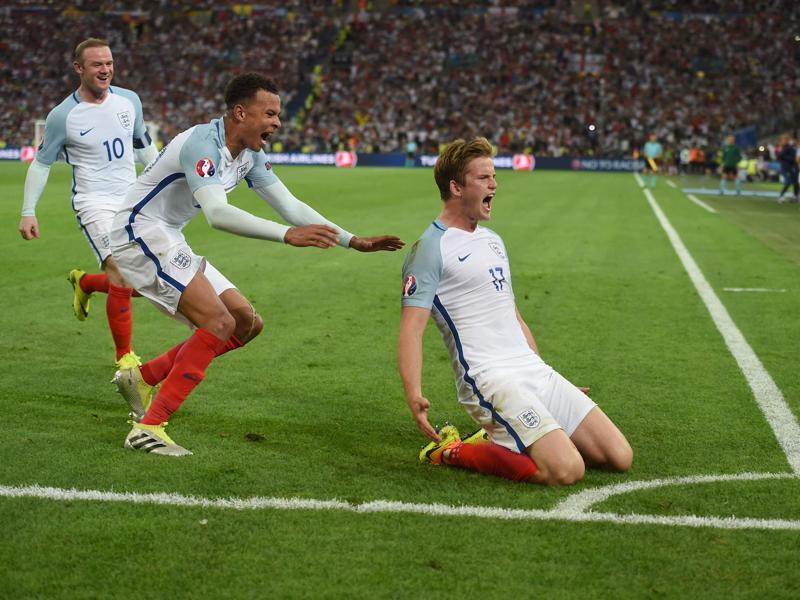 England's midfielder Eric Dier (R) celebrates after scoring England's goal. (AFP)