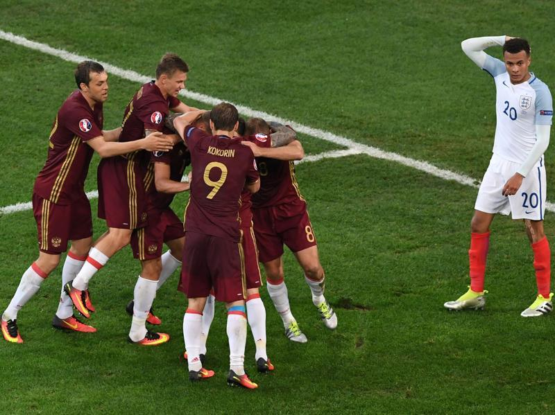 Russia's defender Vasily Berezutskiy (hidden) is congratulated by teammates after scoring a late equaliser for a 1-1 draw in the Euro 2016 group B match against England at the Stade Velodrome in Marseille on June 11, 2016.  (AFP)