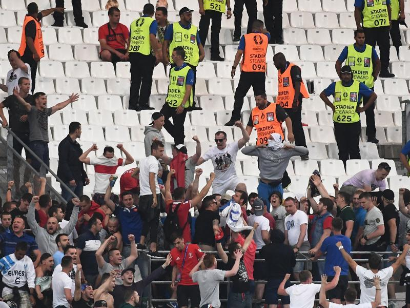 Russian supporters chant slogans during the match. (AFP)