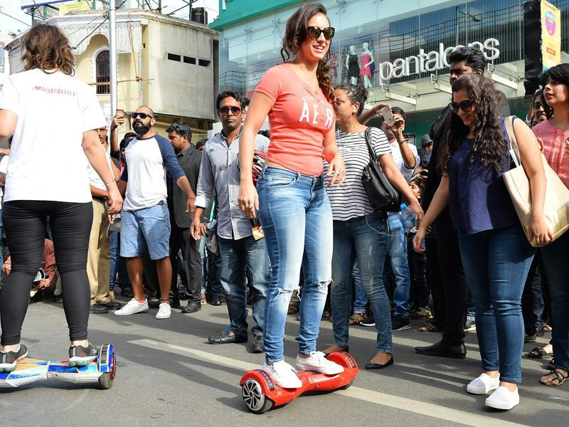 Lauren Gottlieb takes part in an event on a hover board in Bangalore. (AFP)