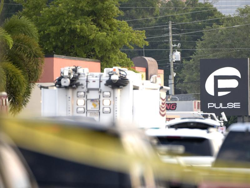 Police cars and emergency vehicles surround the Pulse Orlando nightclub, the scene of a fatal shooting, in Orlando, on Sunday.  (AP)
