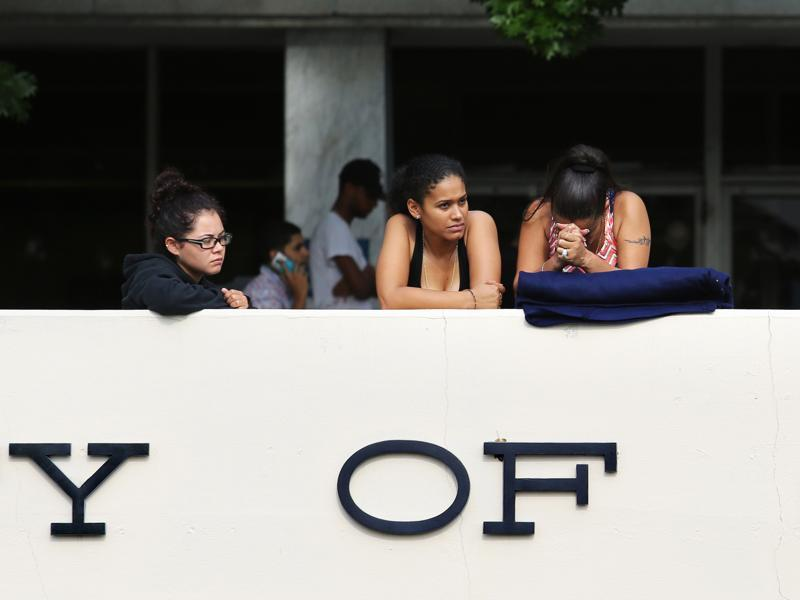 Concerned friends and family of victims at Pulse nightclub, where multiple fatalities were reported, wait outside of the Orlando Police Department, Sunday. (AP)