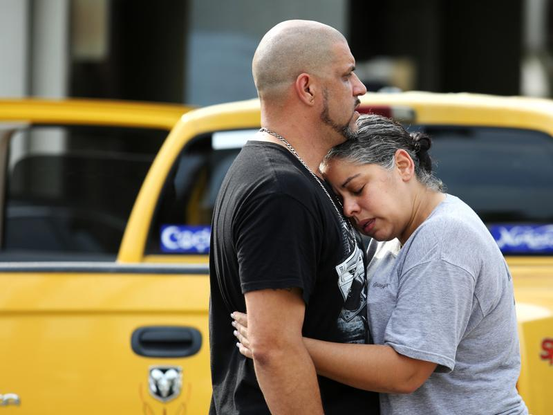 Ray Rivera, a DJ at Pulse Orlando nightclub, is consoled by a friend, outside of the Orlando Police Department after a shooting involving multiple fatalities at the nightclub, Sunday. (AP)