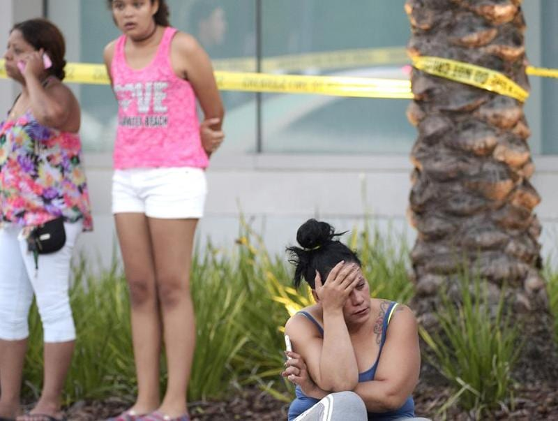 People wait outside the emergency entrance of the Orlando Regional Medical Center hospital after a shooting involving multiple fatalities at Pulse Orlando nightclub in Orlando. (AP)