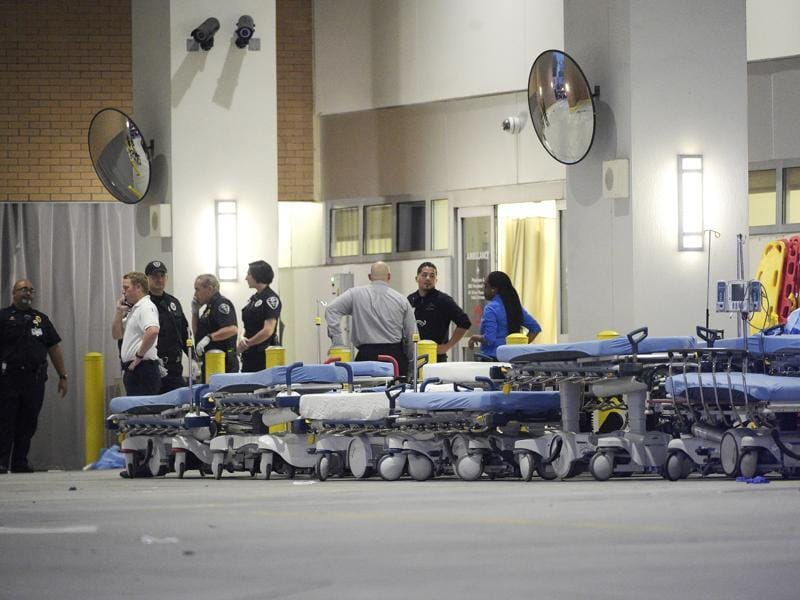 Emergency personnel wait with stretchers at the emergency entrance to Orlando Regional Medical Center hospital for the arrival of patients from the scene of a fatal shooting at Pulse Orlando nightclub. (AP)