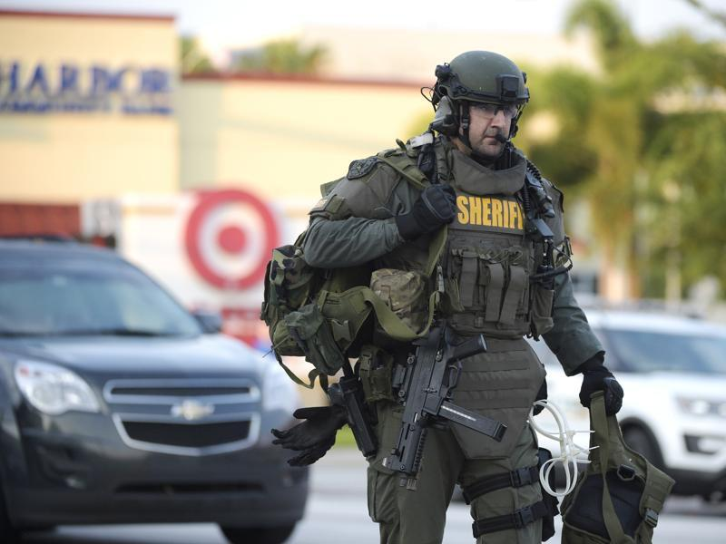 An Orange County Sheriff's Department SWAT member arrives to the scene of a fatal shooting at Pulse Orlando nightclub in Orlando, on Sunday.  (AP)