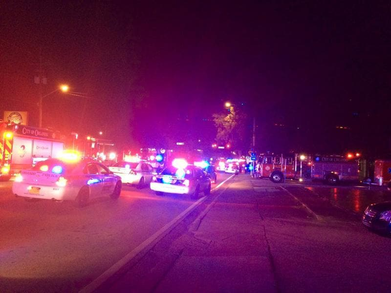 Police cars and fire trucks are seen outside the Pulse night club where police said a  gunman left multiple people dead and injured in Orlando, Florida, June 12, 2016. (REUTERS)