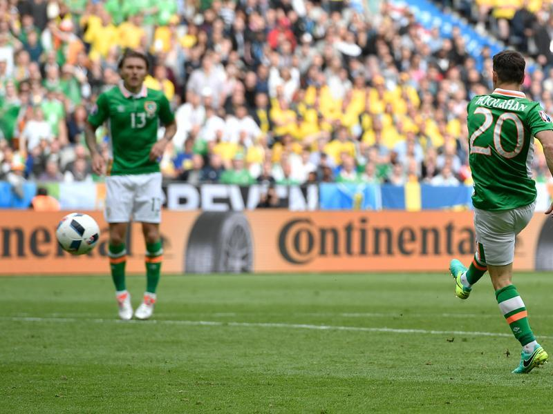 Hoolahan, right, scores the opening goal. (AP)