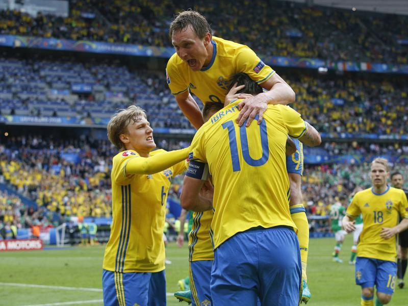 Sweden's Zlatan Ibrahimovic, back to camera, celebrates with Kim Kallstrom, top, and teammates after Ireland's Ciaran Clark scored an own goal, during the Euro 2016 Group E match against Ireland at the Stade de France in Saint-Denis, north of Paris, on June 13, 2016. (AP)