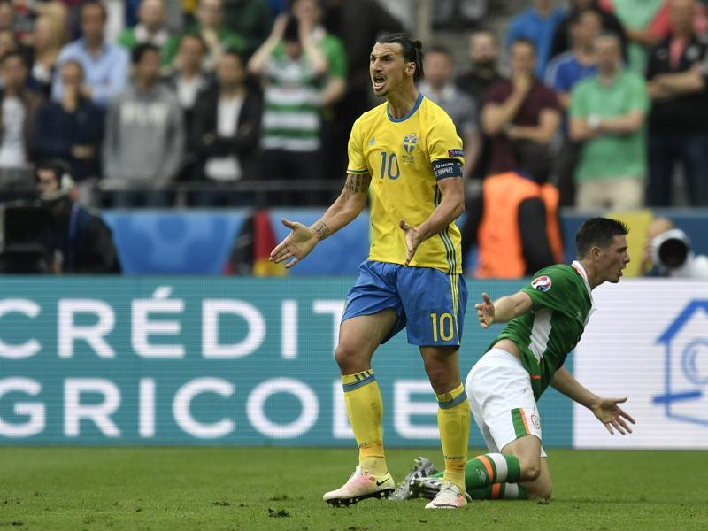 Sweden's Zlatan Ibrahimovic, left, and Ireland's Ciaran Clark engaged in a tussle. (AP)