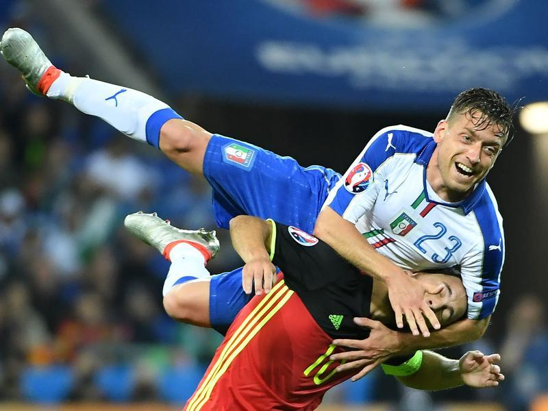 Italy's midfielder Emanuele Giaccherini (up) vies with Belgium's forward Eden Hazard. (AFP Photo)