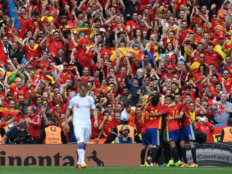 Czech Republic's defender David Limbersky walks past as Spain's players celebrate after defender Gerard Pique scored the winning goal during the Euro 2016 group D match at the Stadium Municipal in Toulouse on June 13, 2016. Spain won the match 1-0. (AFP)