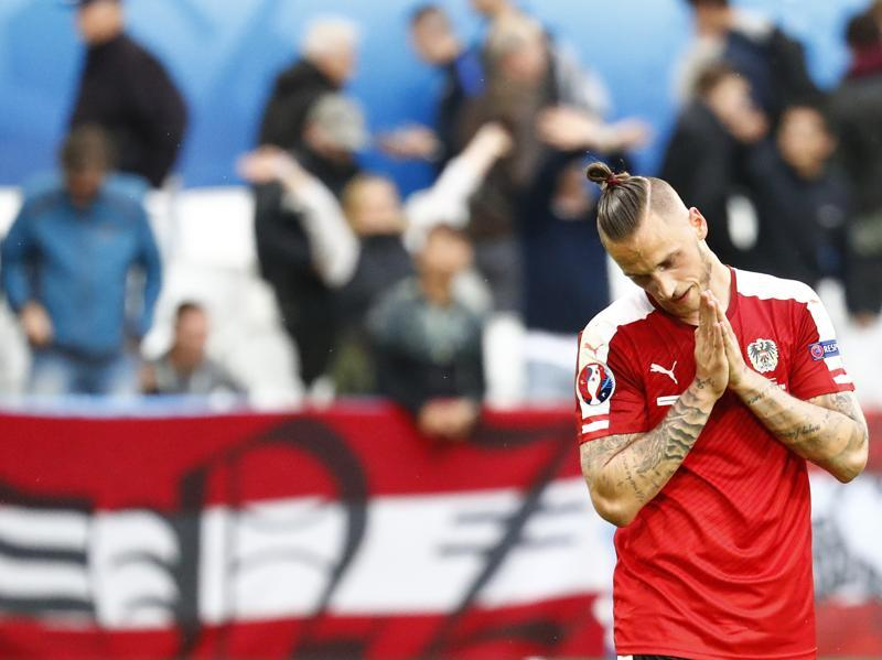 Austria's Marko Arnautovic looks dejected at the end of the match after they were defeated 2- 0 by Hungary. (Reuters Photo)