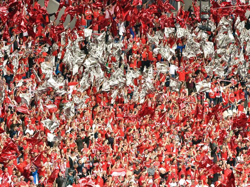 Austria fans cheer for their team during the Euro 2016 group F football match between Hungary and Austria. (AFP Photo)