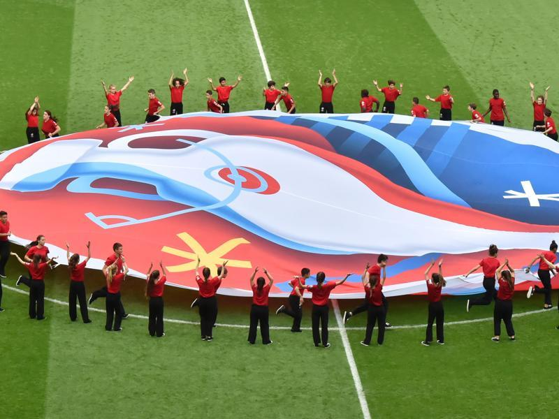 Volunteers display the Euro 2016 logo before the start of the Euro 2016 group F football match between Hungary and Austria at the Matmut Atlantique stadium. (AFP Photo)