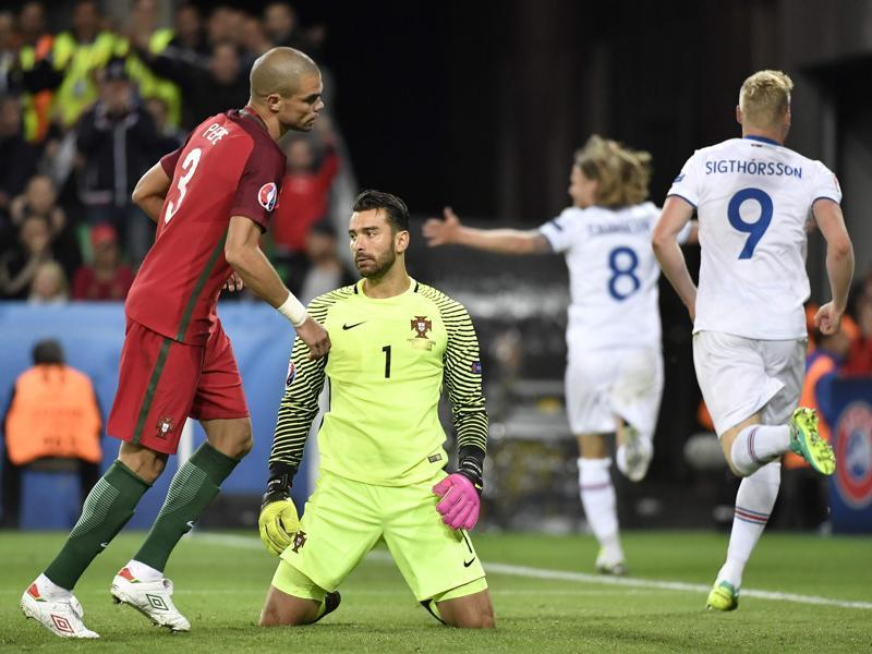 Portugal's Pepe, left, and goalkeeper Rui Patricio look disappointed after Iceland equalise. (AFP)