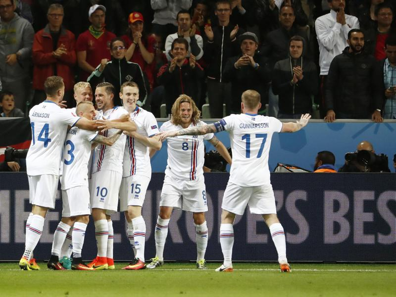 Iceland players celebrate the goal that gave them their first points in their debut appearance in the European Championships. (AFP)