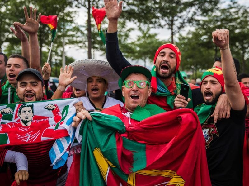 Portuguese football supporters sing and chant as they wait to enter the Geoffroy-Guichard stadium in Saint-Etienne, prior to the match between Portugal and Iceland.  (AFP Photo)