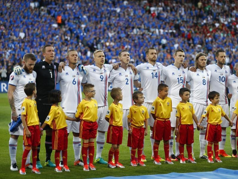 Iceland players line up for the national anthems before their match against Portugal. (Reuters Photo)