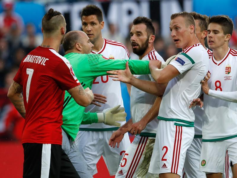 Hungary goalkeeper Gabor Kiraly (2nd left) pushes his teammates away from Austria's Marko Arnautovic as they argue during the Euro 2016 Group F football match. (AP Photo)