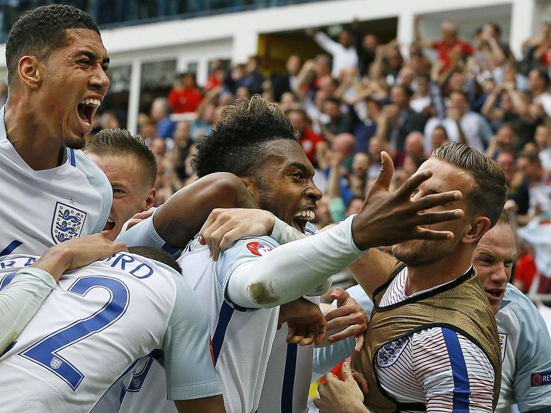 England's Daniel Sturridge, centre, celebrates after scoring his side's second goal during the Euro 2016 Group B match against Wales at the Bollaert stadium in Lens, France, on June 16, 2016. (AP)