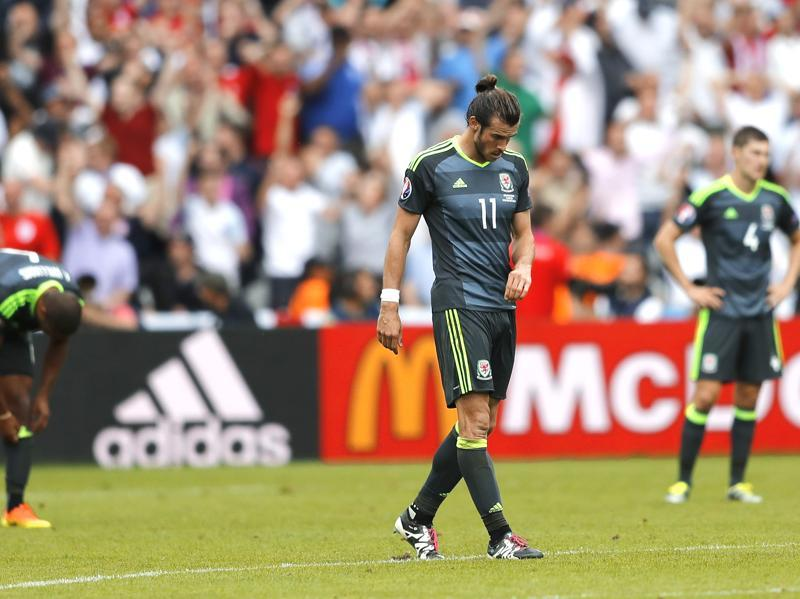 Wales' Gareth Bale, centre, looks dejected after his side's 1-2 defeat. (AP)