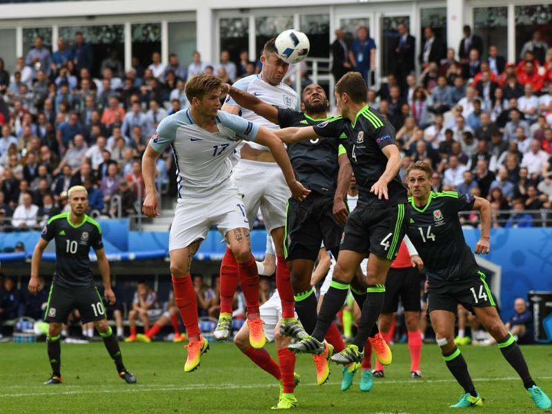 England's Gary Cahill, centre, heads the ball. (AP)