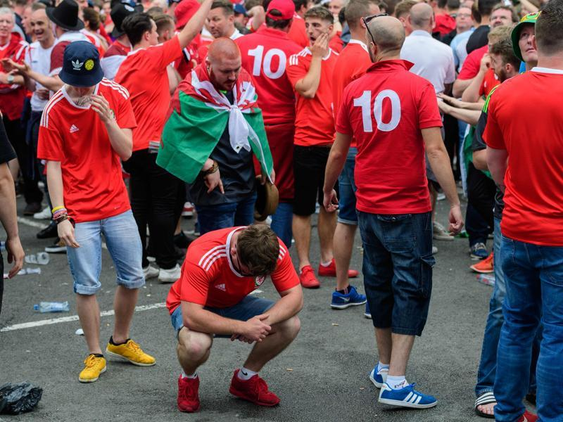 Dejected Wales supporters show their feelings in the fanzone in central Lens as England beat Wales 2-1. (AFP photo)