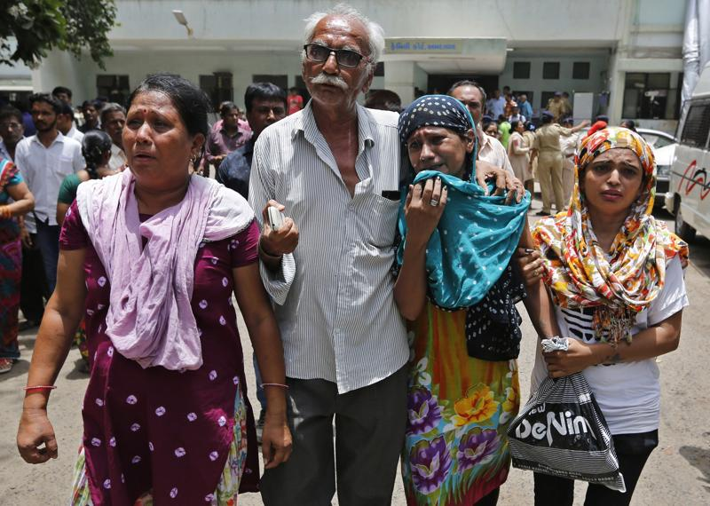 Relatives of a convict in the 2002 Gujarat riots case react after the court announced the lengths of the sentences in Ahmadabad. (AP)