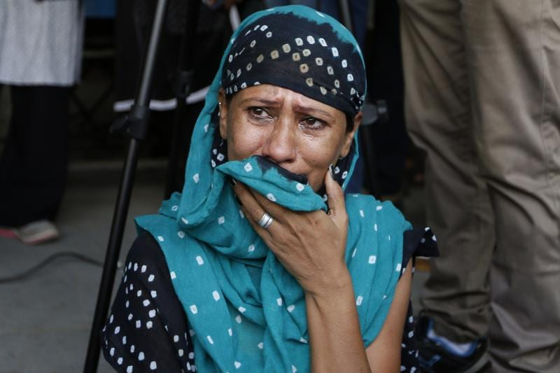 A relative of a convict in the 2002 Gujarat riots case cries after the court announced the lengths of the sentences in Ahmadabad. (AP)