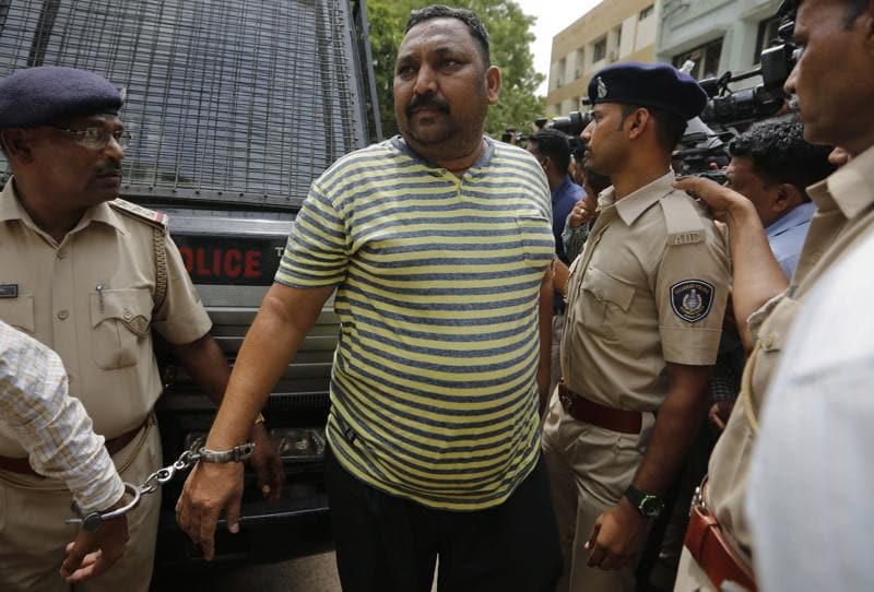 A man convicted for the 2002 Gujarat riots is brought to court in Ahmadabad. (AP)