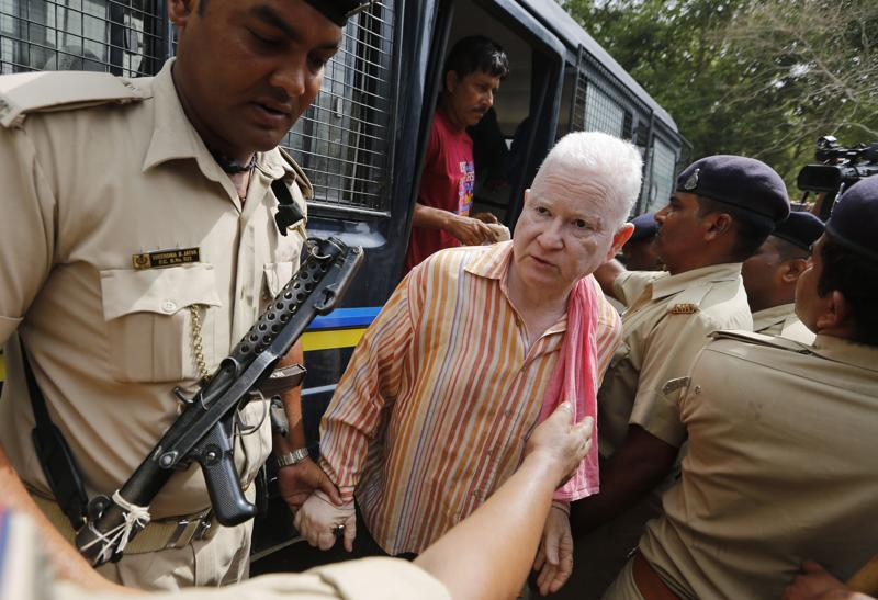 A person convicted on charges from the 2002 Gujarat riots is brought to court in Ahmadabad.  (AP)
