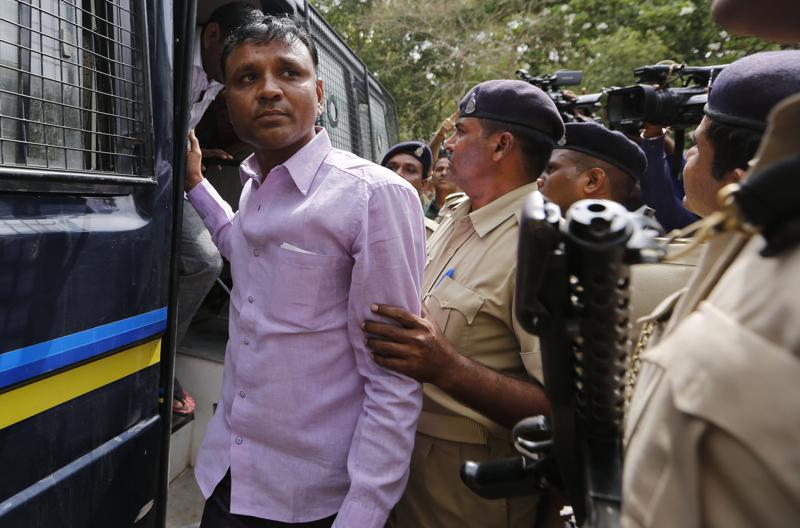 Man convicted for the 2002 Gujarat riots is brought to court in Ahmadabad. (AP)