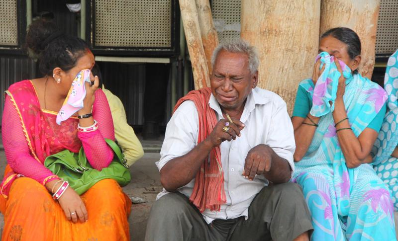 Relatives of Kailas Dhobi, convicted in connection with a riot in Gujarat in 2002, cries after the verdict.  (Siddharaj Solanki/Hindustan Times)