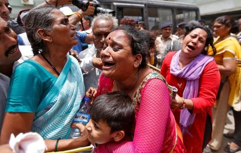 Relatives of those convicted in connection with a riot in Gujarat in 2002, cry outside a court after the sentencing in Ahmedabad. (reuters)