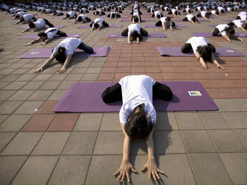Participants strike a pose during a group yoga session at a park in Beijing. (AP)