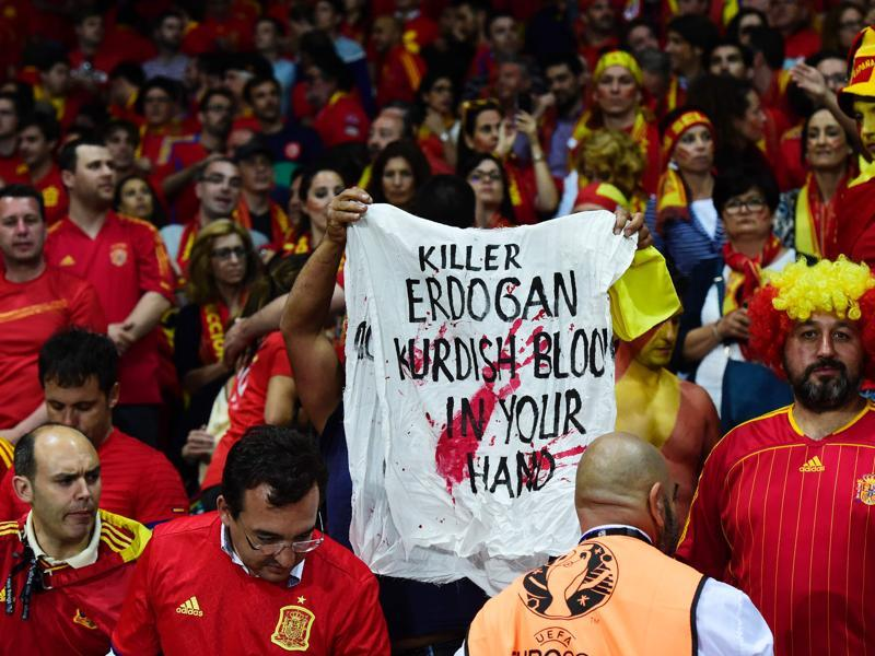 A man carries a banner during the Euro 2016 group D football match. (AFP photo)