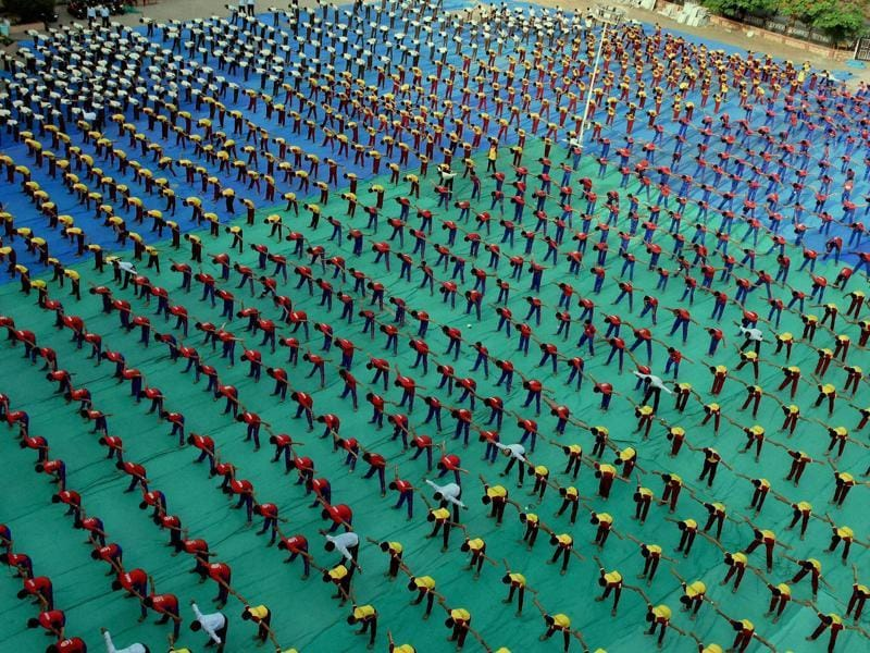Students perform yoga ahead of International Yoga day in Surat.  (PTI)