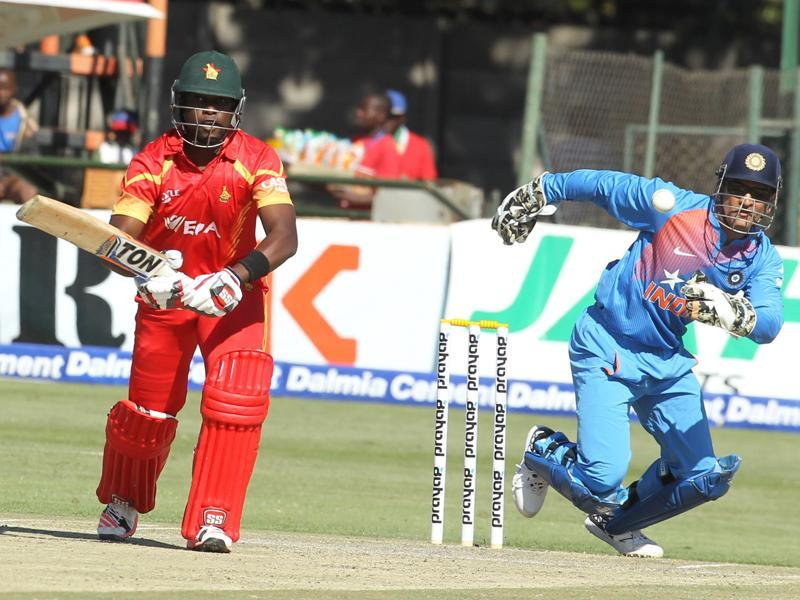 Dhoni runs to collect a shot hit by Elton Chigumbura. (AP)