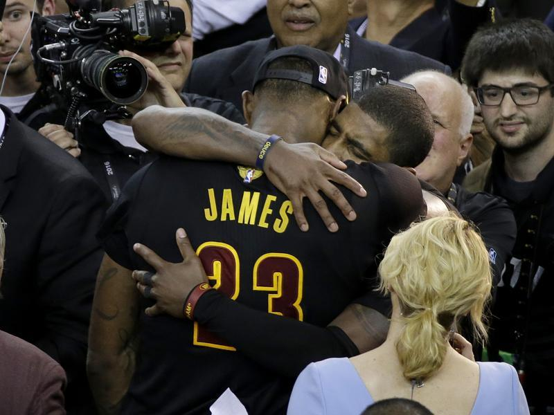 LeBron James (23) hugs teammate Kyrie Irving after the win. (AP)