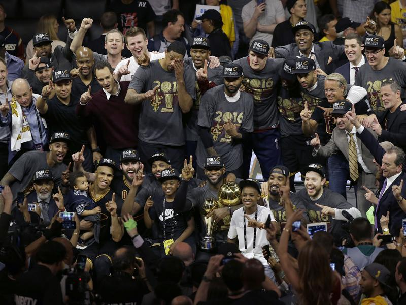 The Cavs pose for a photo with teammates, family and staff. (AP)