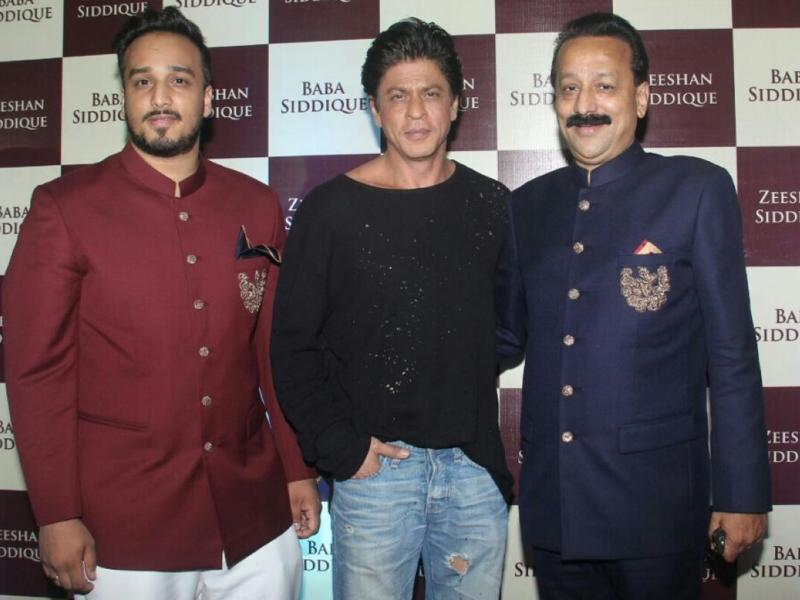 Shah Rukh Khan with Baba Siddique and his son Zeeshan during the Iftar party hosted by the Congress leader on Sunday.  (IANS)