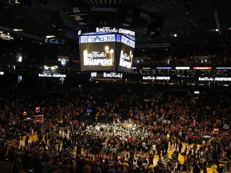 The Cleveland Cavaliers celebrate their championship victory at the Oracle Arena. (Reuters)