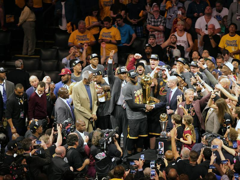 LeBron James is congratulated by the NBA commissioner as the Cavs celebrate their win. (Reuters)
