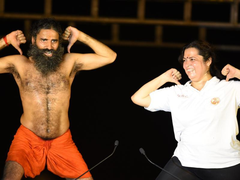 Ramdev teaches yoga to BJP leader Meenakshi Lekhi. (Virendra singh gosain/ht photo)