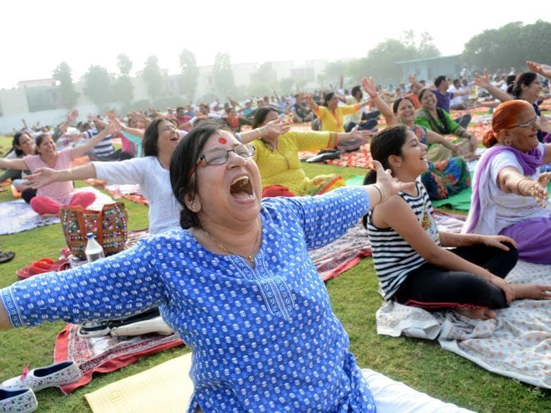 People perform yoga  asanas at a camp in Ghaziabad. (Sakib Ali/HT Photo)