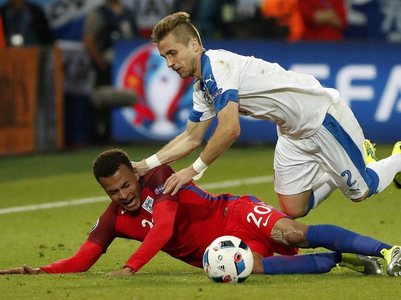 Slovakia's Peter Pekarik falls on top of England's Dele Alli during the Euro 2016 Group B football match between Slovakia and England. (AP Photo)
