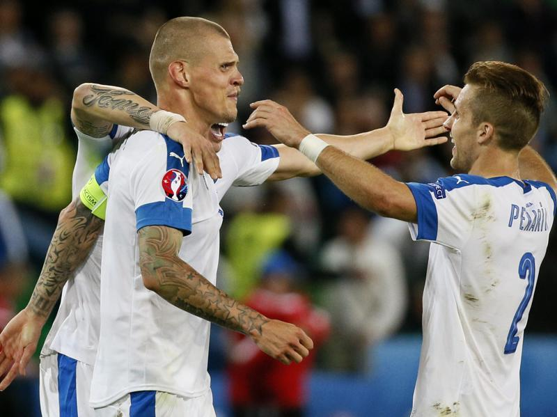 Slovakia's Martin Skrtel and Peter Pekarik at the end of their game against England, at Stade Geoffroy-Guichard, Saint-Étienne, France. (Reuters Photo)